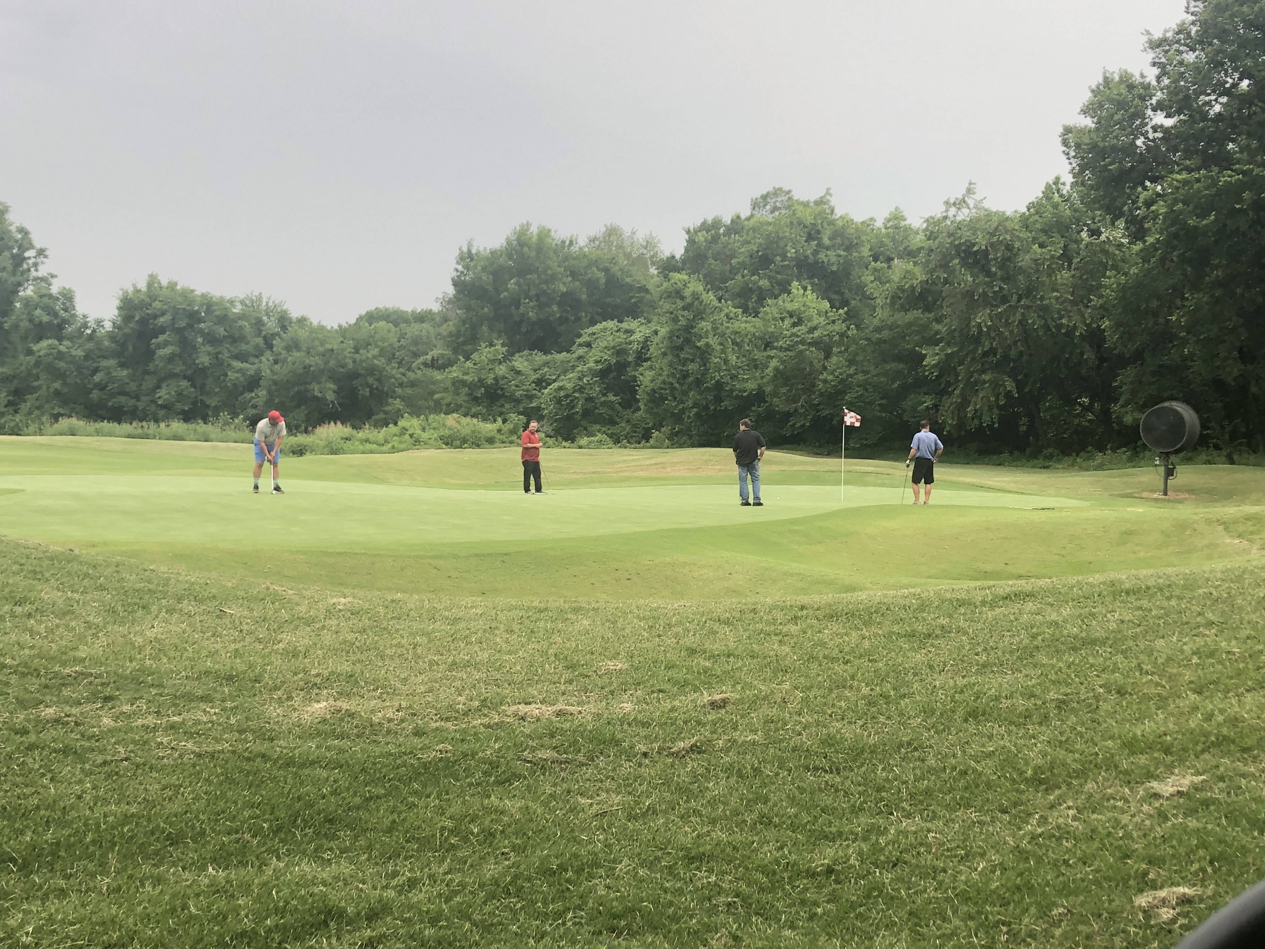 Golfers on a putting green