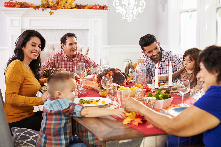 Family with grandparents enjoying Thanksgiving dinner
