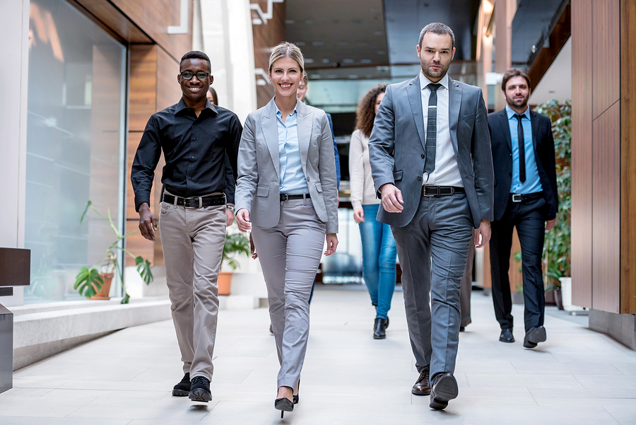 Young business professionals walking